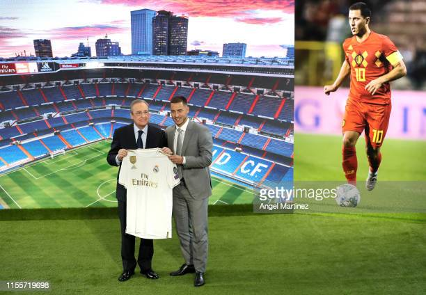 New Real Madrid signing Eden Hazard is unveiled by Florentino Perez President of Real Madrid at Estadio Santiago Bernabeu on June 13 2019 in Madrid...
