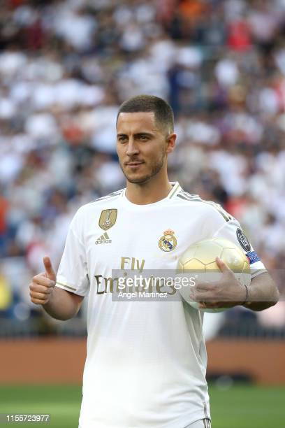 New Real Madrid signing Eden Hazard poses for a photo as he is unveiled at Estadio Santiago Bernabeu on June 13 2019 in Madrid Spain