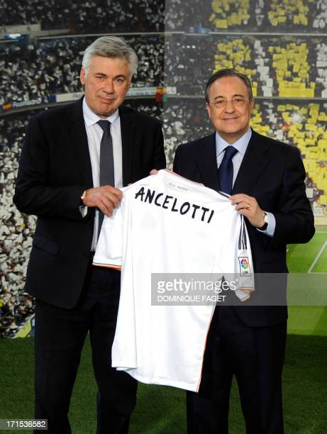 New Real Madrid's Italian coach Carlo Ancelotti poses with his new team's jersey flanked by Real Madrid's president Florentino Perez during his...