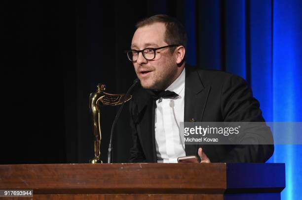New Reality Company cofounder Winslow Porter accepts the Lumiere Award for Best VR Location Baed Animated Short onstage at the Advanced Imaging...