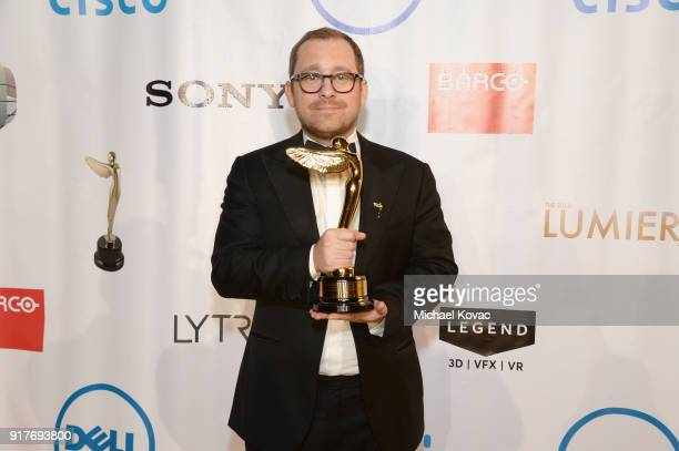 New Reality Company cofounder Winslow Porte poses with the Lumiere Award for Best VR Location Based Animation Short at the Advanced Imaging Society...