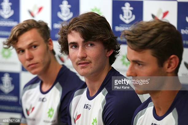 New recruit Connor Blakely looks on with Ed Langdon and Lachlan Weller while being introduced to the media during a Fremantle Dockers AFL media...