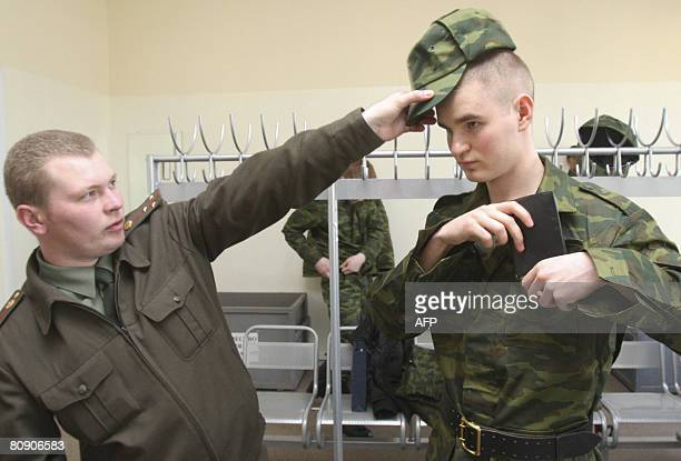New recruit in the Russian Presidential regiment in St. Petersburg has his new hat adjusted by a superior on April 29, 2008. In addition to the usual...