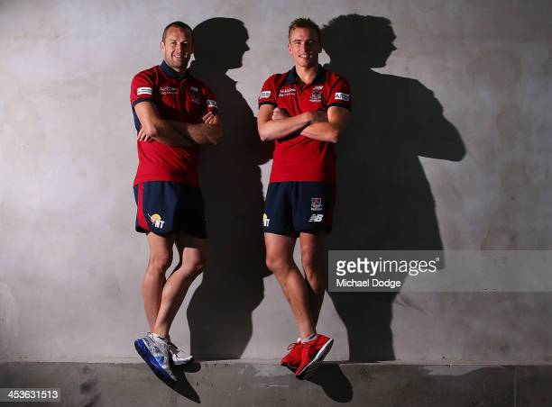 New recruits Bernie Vince and Daniel Cross pose during a Melbourne Demons AFL media session at AAMI Park on December 5 2013 in Melbourne Australia
