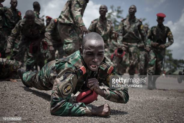 TOPSHOT New recruits for the Central African Armed Forces celebrate their graduation in Berengo on August 4 2018 Russian military consultants have...