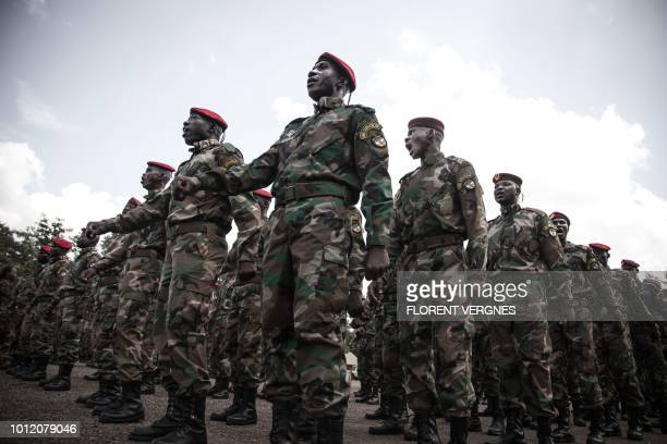 New recruits for the Central African Armed Forces march in formation during an award presentation in Berengo on August 4 2018 Russian military...