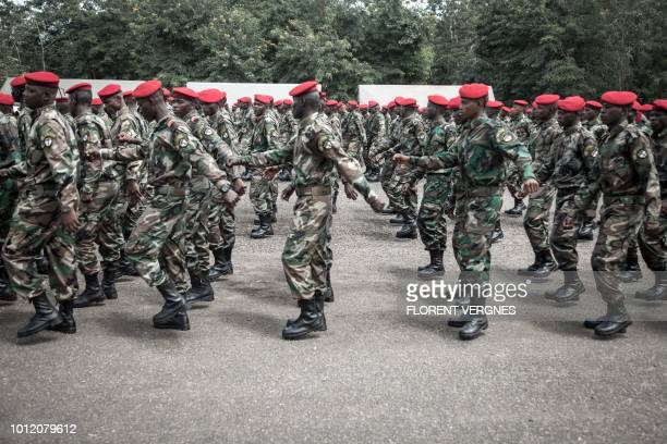New recruits for the Central African Armed Forces march in formation during an award presentation in Berengo on August 4, 2018. - Russian military...