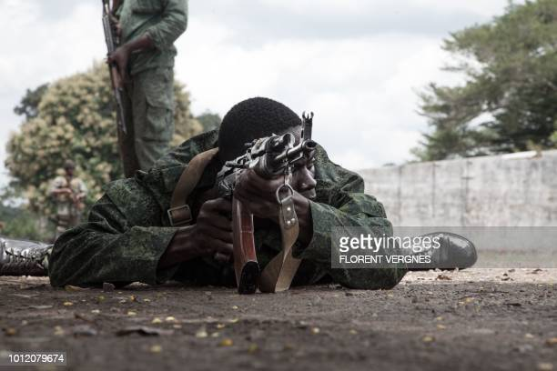 New recruits for the Central African Armed Forces perform a drill during a medal presentation demonstration in Berengo on August 4 2018 Russian...