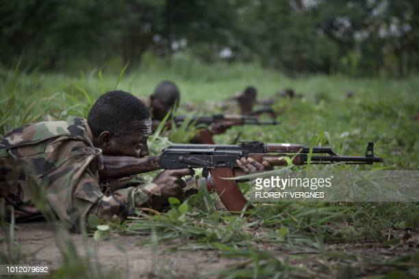 New recruits for the Central African Armed Forces perform a drill during a medal presentation demonstration in Berengo on August 4, 2018. - Russian...