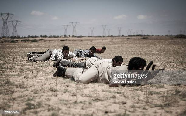 New recruits in the Captain katiba conduct manoeuvre training in an open area just east of Misrata, Libya, 13 June 2011. Various brigades made up of...
