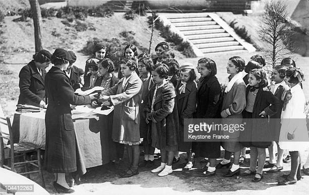 New recruits in the Italian feminine Fascists youth the Piccole Italiane receiving their uniforms in Rome in 19261936 The Fascist organization for...