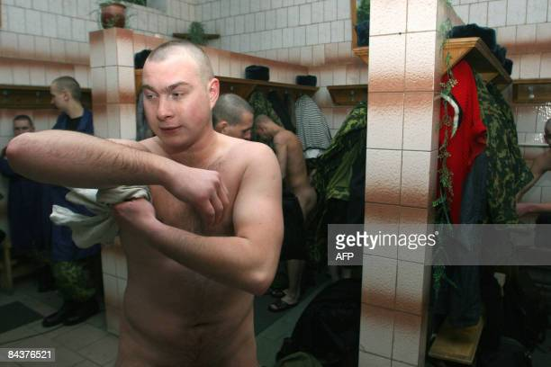 New recruits into the Belarussian army shower after having their heads shaved at a barracks in Minsk on January 20 2009 on their first day of service...