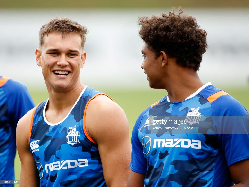 New recruits Kyron Hayden (left) and Gordon Narrier of the Kangaroos chat during the North Melbourne Kangaroos training session at Arden St on December 4, 2017 in Melbourne, Australia.