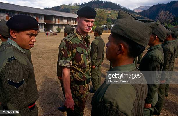New recruits of the British Royal Gurkha Regiment parade before taking official oaths on the Union Jack flag at their army camp in Pokhara Nepal...