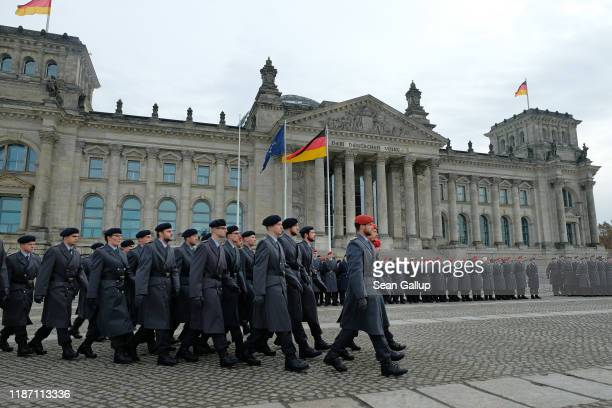 New recruits of the Bundeswehr the German armed forces arrive to take their oath of service in front of the Reichstag on November 12 2019 in Berlin...