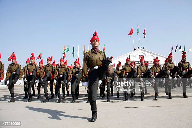 New recruits of the Jammu Kashmir Light Infantry Regiment take oath during a passing out parade at an army base on March 8 2014 in Srinagar India The...