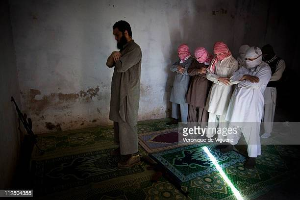 New recruits praying while being trained under the authority of Abdul Rehman who claimed they were part of the LashkareTaiba Islamist militant group...