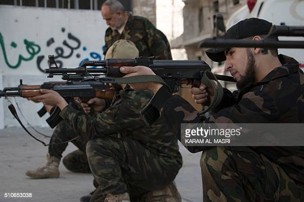 New recruits take part in a shooting training session on February 16 2016 at a camp in a rebelheld area of the northern city of Aleppo before...
