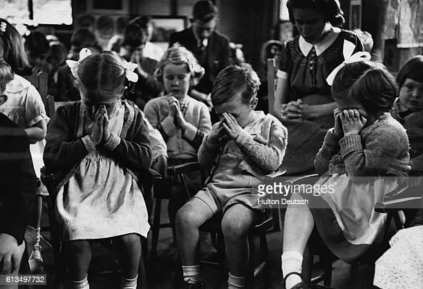 New recruits to Bicester Sunday School attend a service in the school's Happy Hut | Location Bicester Oxfordshire England UK