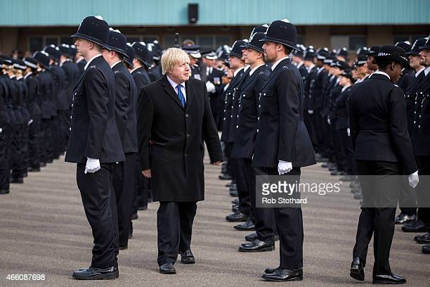 New recruits to the Metropolitan Police Service are greeted by Mayor of London Boris Johnson during their 'Passing Out Parade' at Hendon Training...