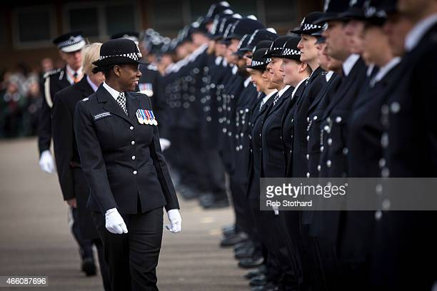 New recruits to the Metropolitan Police Service are inspected by Deputy Director of Training Superintendent Robyn Williams during their 'Passing Out...
