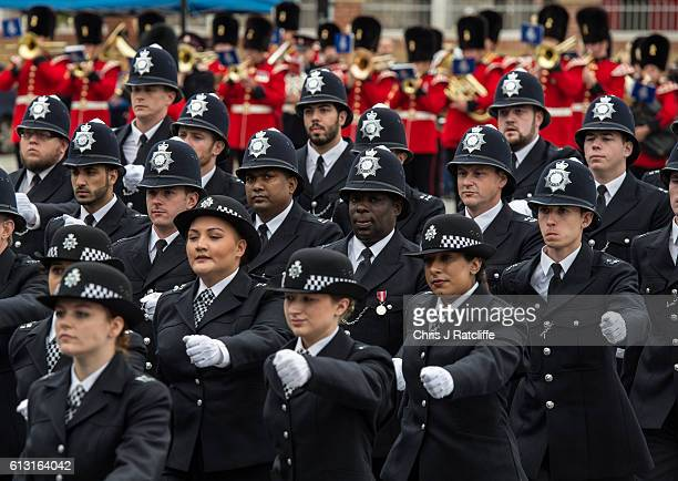 New recruits to the Metropolitan Police Service take part in their 'Passing Out Parade' outside Peel House at Hendon Police College on October 7 2016...