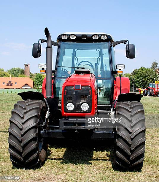 New red tractor in a farm without any leader