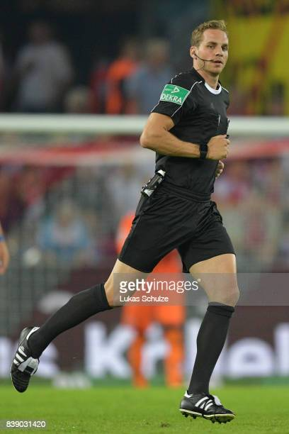 New referee Soeren Storks during the Bundesliga match between 1 FC Koeln and Hamburger SV at RheinEnergieStadion on August 25 2017 in Cologne Germany
