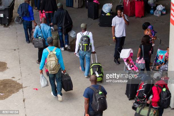 New refugees arrive at Olympic Stadium in Montreal Quebec August 5 2017 The stadium has been turned into a shelter for hundreds of refugees who have...