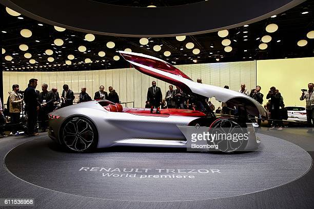 A new Renault Trezor concept automobile produced by Renault SA sits on display during the second press day of the Paris Motor Show at Porte de...