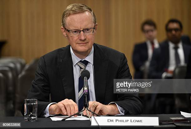 New Reserve Bank of Australia Governor Philip Lowe sits at a table for a parliamentary economics committee hearing in Sydney on September 22 2016...