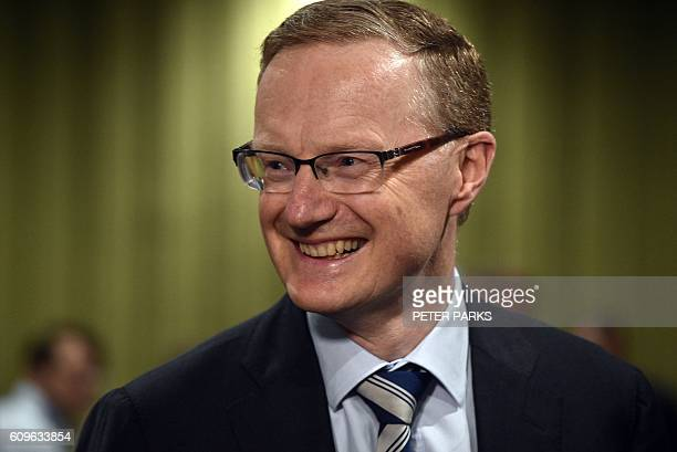 New Reserve Bank of Australia Governor Philip Lowe smiles as he arrives for a parliamentary economics committee hearing in Sydney on September 22...