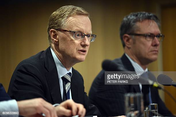 New Reserve Bank of Australia Governor Philip Lowe speaks at a parliamentary economics committee hearing flanked by new Deputy Governor Guy Debelle...