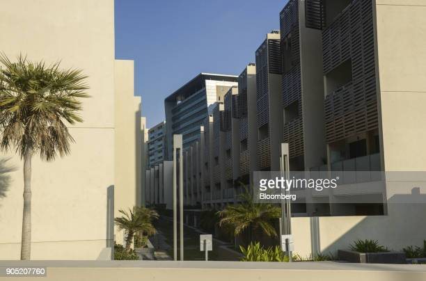 New residential apartment blocks stand in the Al Muneera gated enclave developed by Carillion Plc and AlFuttaim Group along the Al Raha waterfront in...