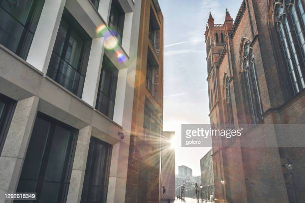 new residential architecture in central berlin beside historic friedrichwerdersche church - central berlin stock pictures, royalty-free photos & images