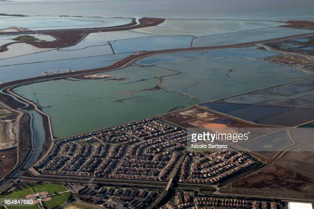 new residential complex next to marshes from above - hayward california stock pictures, royalty-free photos & images