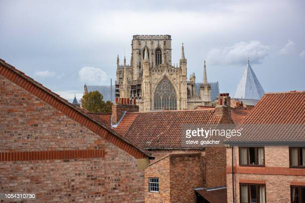 a new residential district in the shadows of the ancient york minster in england. - york minster stock photos and pictures