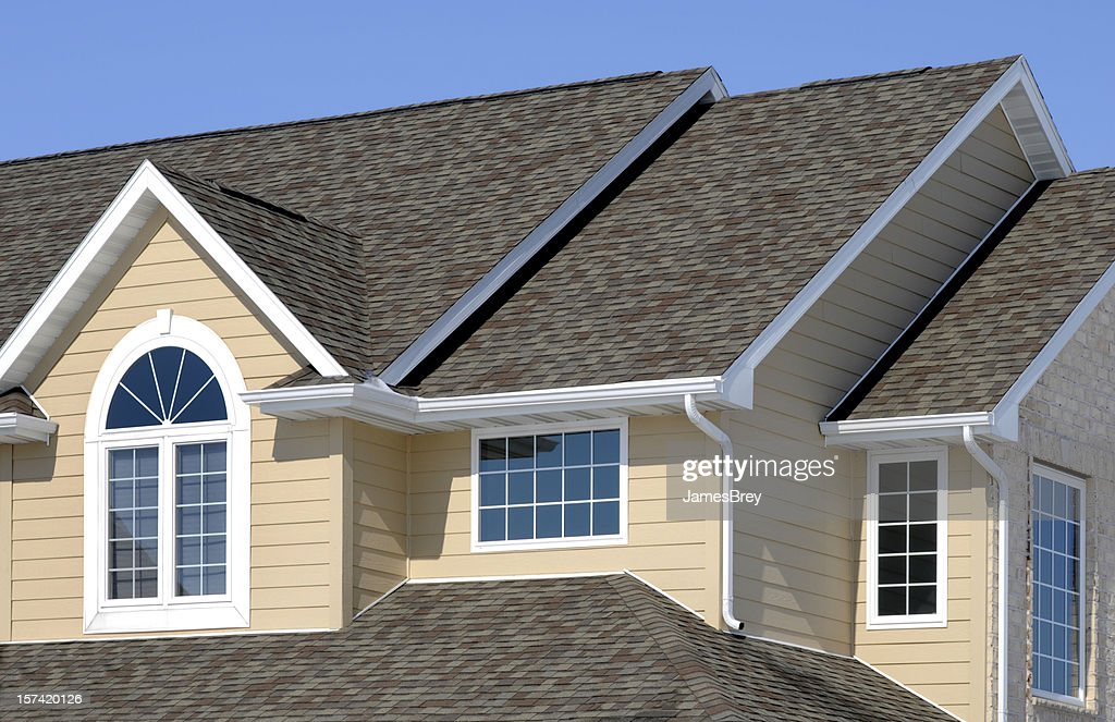 New Residential House; Architectural Asphalt Shingle Roof, Vinyl Siding, Gables : Stock Photo