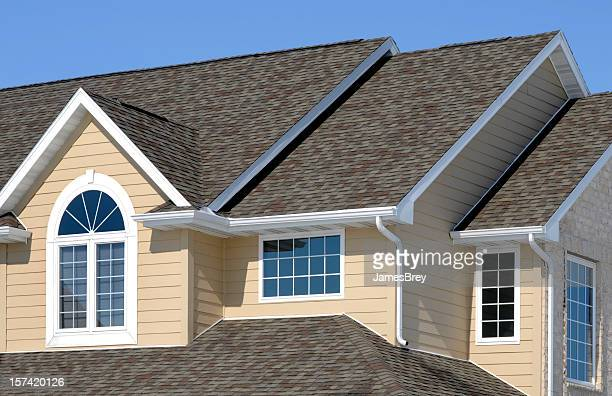 new residential house; architectural asphalt shingle roof, vinyl siding, gables - roof stock pictures, royalty-free photos & images