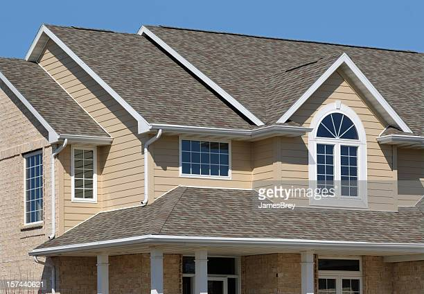 new residential house; architectural asphalt shingle roof, vinyl siding - roof stock pictures, royalty-free photos & images
