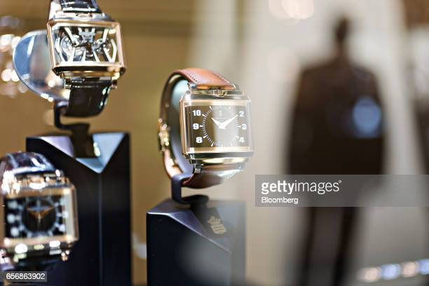 A New Retro model luxury wristwatch right produced by De Grisogono SA stands on display during the 2017 Baselworld luxury watch and jewelry fair in...
