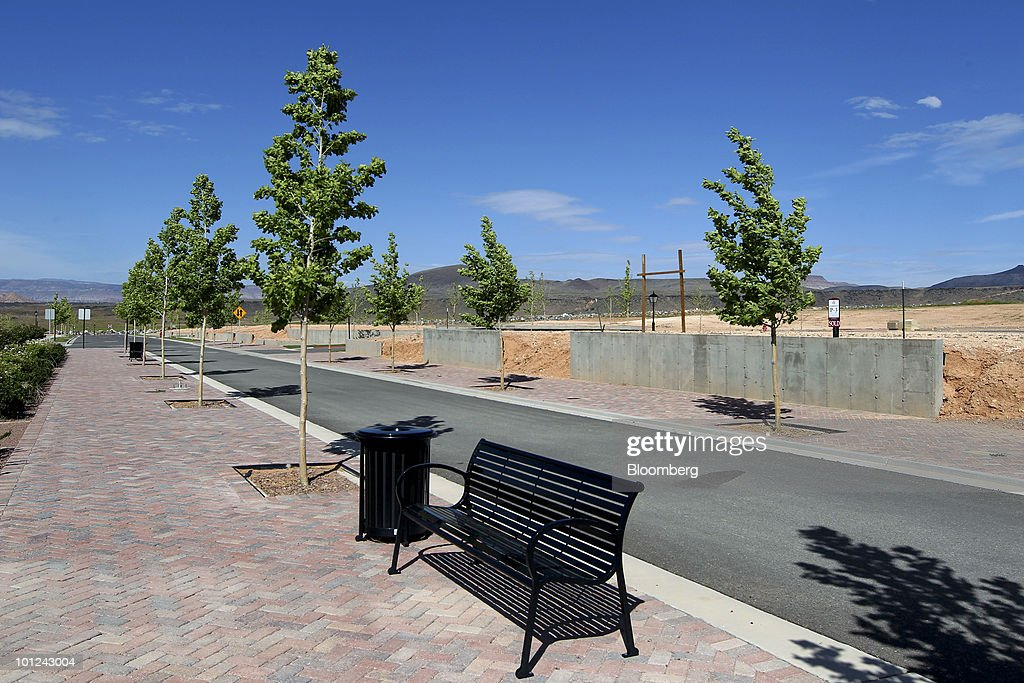 A new road and sidewalks run between undeveloped home lots at the Elim Valley development in St. George, Utah, U.S., on Wednesday, May 26, 2010. Housing starts rose to a 672,000 annual rate last month, the highest since October 2008 and up 5.8 percent from March, Commerce Department figures showed this month. After almost five years of falling sales and prices, homebuilders are looking to see if the nation's fledgling economic recovery can sustain the real estate market as government subsidies end. Photographer: George Frey/Bloomberg via Getty Images