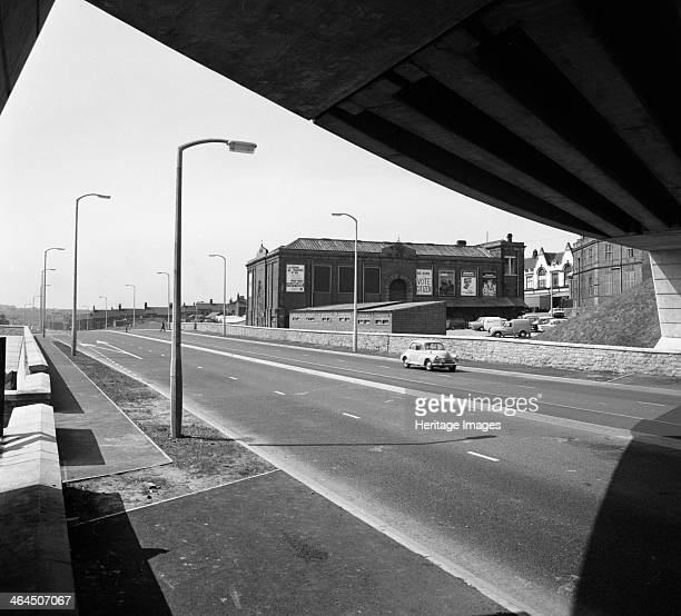 New road development beside the Old Market Hall Mexborough South Yorkshire 1970 A Morris Minor makes its way up the new road development which...