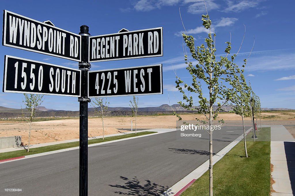 New roads and sidewalks run between undeveloped home lots at the Elim Valley development in St. George, Utah, U.S., on Wednesday, May 26, 2010. Housing starts rose to a 672,000 annual rate last month, the highest since October 2008 and up 5.8 percent from March, Commerce Department figures showed this month. After almost five years of falling sales and prices, homebuilders are looking to see if the nation's fledgling economic recovery can sustain the real estate market as government subsidies end. Photographer: George Frey/Bloomberg via Getty Images