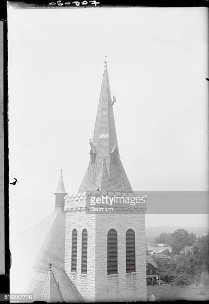 Steeplejack Joseph Beck at work on the steeple of the Salem Baptist Church in New Rochelle which was badly damaged by the freak storm that swept N Y...