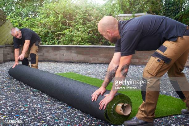new roll of artificial grass - turf stock pictures, royalty-free photos & images