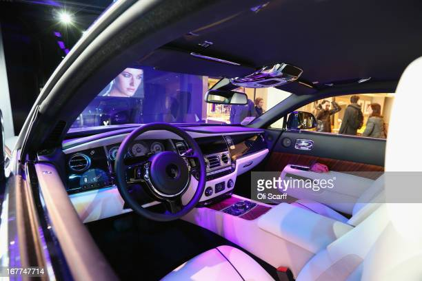 A new RollsRoyce Wraith coupé car is displayed in a window of Harrods department store on April 29 2013 in Knightsbridge London England The Wraith...