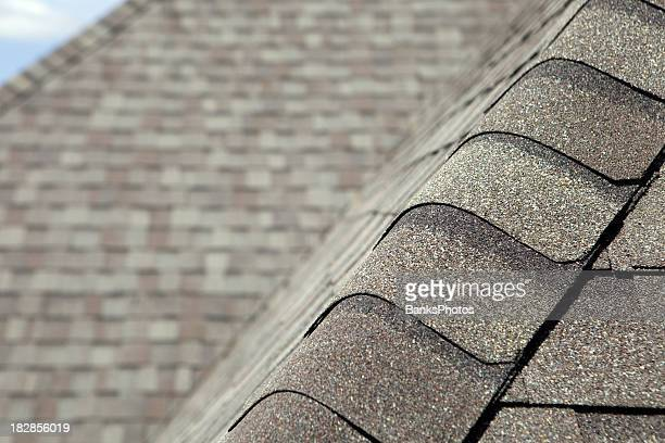 new roof cap leads to valley and blurred shingles - roof stock photos and pictures