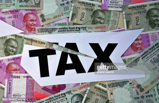 new rupees notes & income tax, india - economy stock pictures, royalty-free photos & images