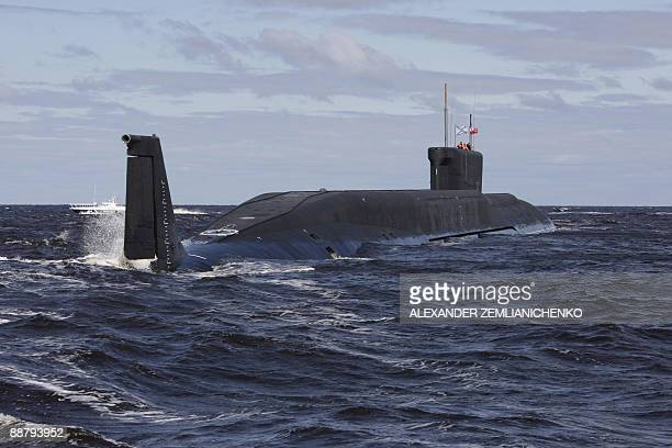 A new Russian nuclear submarine the Yuri Dolgoruky drives in the water area of the Sevmash factory in the northern city of Arkhangelsk on July 2 2009...